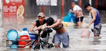 Người Philippines vật lộn với lụt vì bão Sơn Tinh