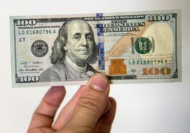 Bị phạt 90 triệu đồng vì đổi 100 USD ở tiệm vàng