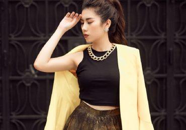 Dương Yến Nhung diện váy xếp ly óng ánh bừng sáng tiết trời Đông